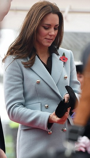 Kate checks her purse in Wales