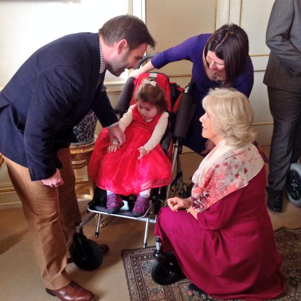 Camilla greeting child