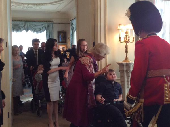 Camilla introducing children to her equerry