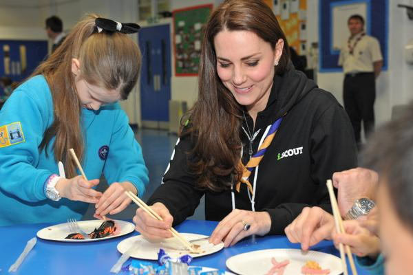 Kate using chopsticks with Scouts