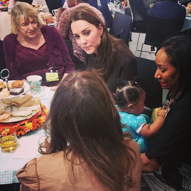 Kate has tea with foster carers and children at the Fostering Network