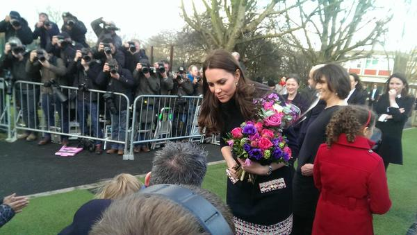 Kate leaves Art Room with flowers