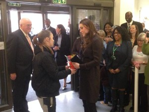 Kate received flowers as she leaves Foster Network