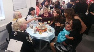 Kate shakes hand over tea at Fostering Network