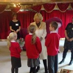 Camilla meets Red Hall School students at reading workshop for Seven Stories