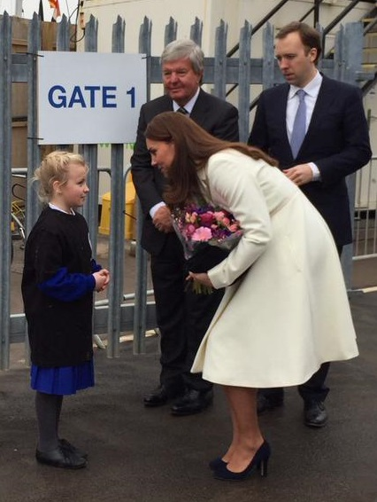 Kate receives flowers from kid small