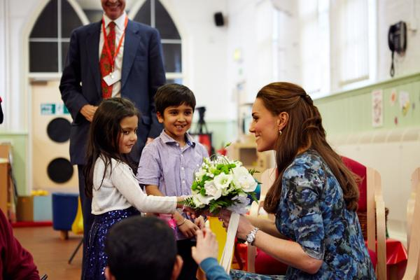 Kate receiving flowers at Action for Children
