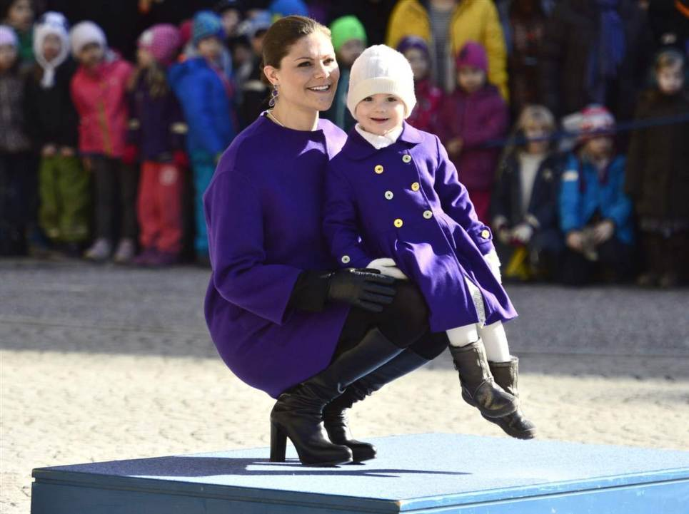 Estelle sitting on Victoria's lap during Crown Princess Name Day