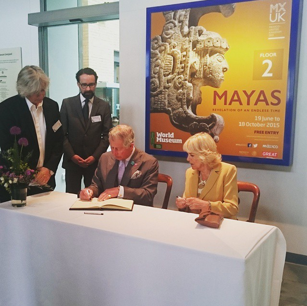 Charles and Camilla signs visitor's book at World Museum in Liverpool