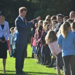 Prince Harry chats to kids at Government House