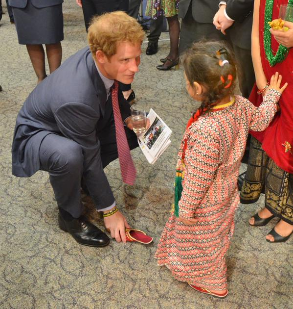 Prince Harry helps little girl with shoe