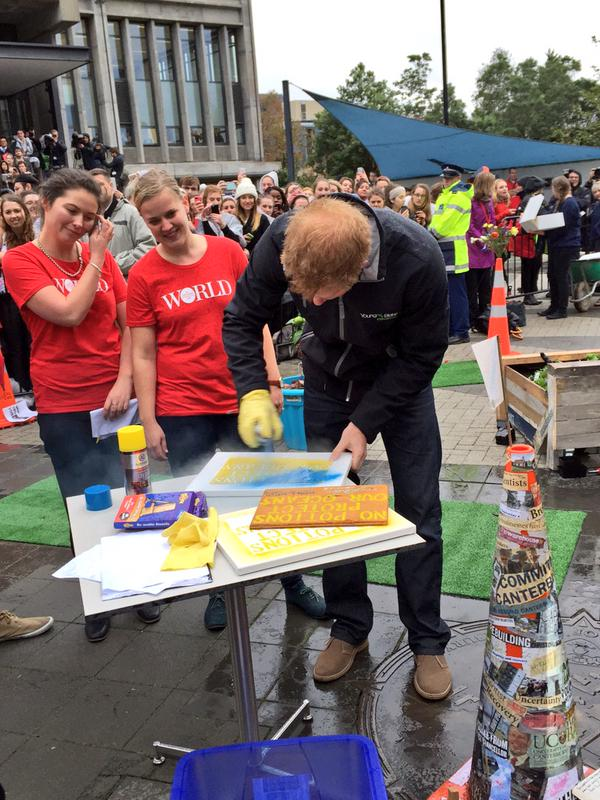 Prince Harry paints sign in Christchurch