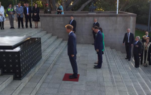 Prince Harry pays respects at tomb of unknown warrior