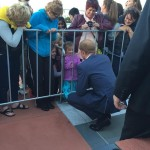 Prince Harry talks to girl during walkabout