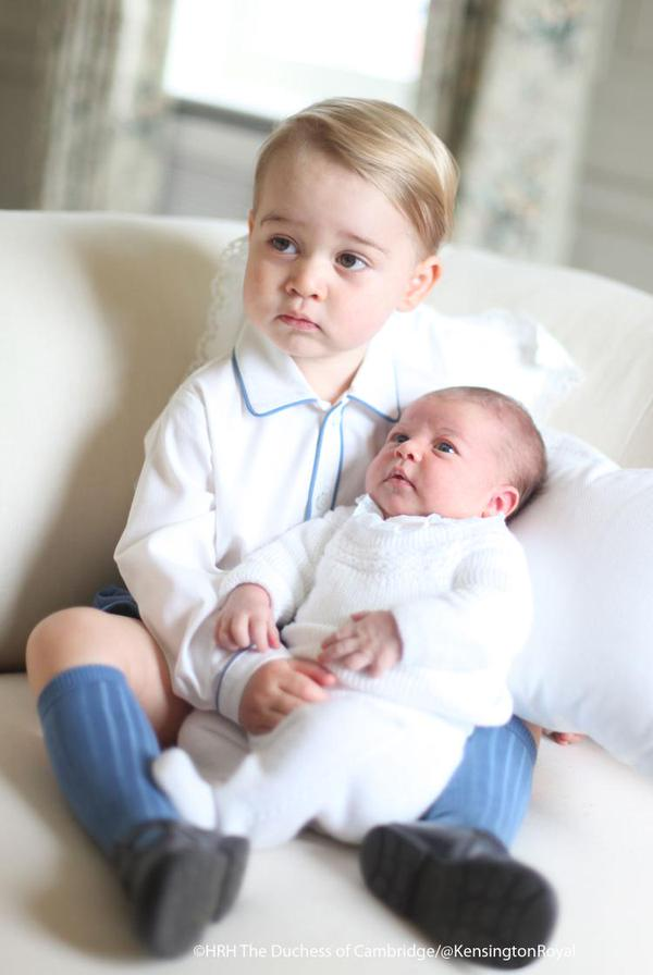 Prince George holding Princess Charlotte taken by Kate Middleton
