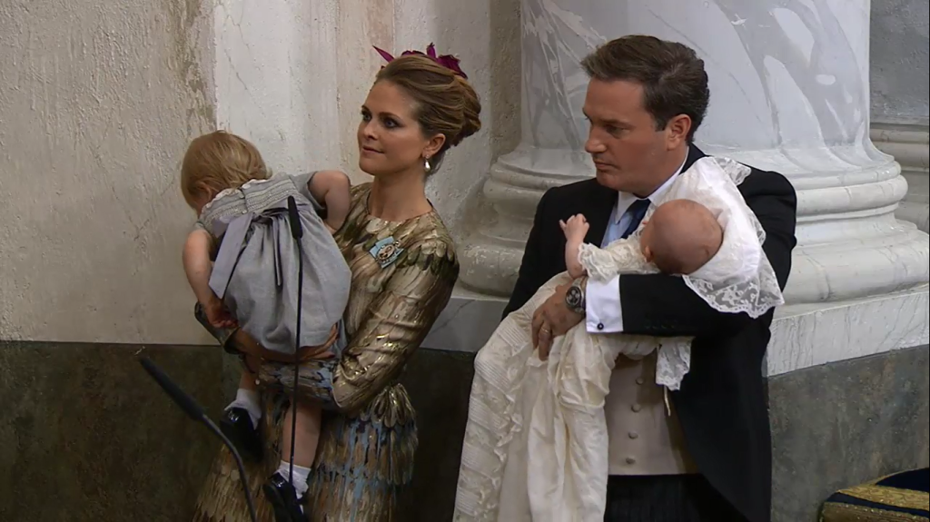 Leonore squirming at Prince Nicolas Christening