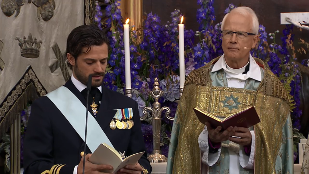 Prince Carl Philip gives reading at Prince Nicolas Christening