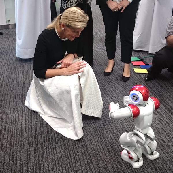 Sophie with robot in Qatar