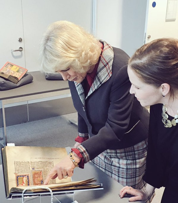 Camilla looking at rare book at Duncan Rice Library