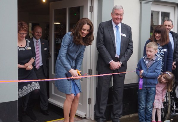 Kate cutting ribbon EACH charity shop