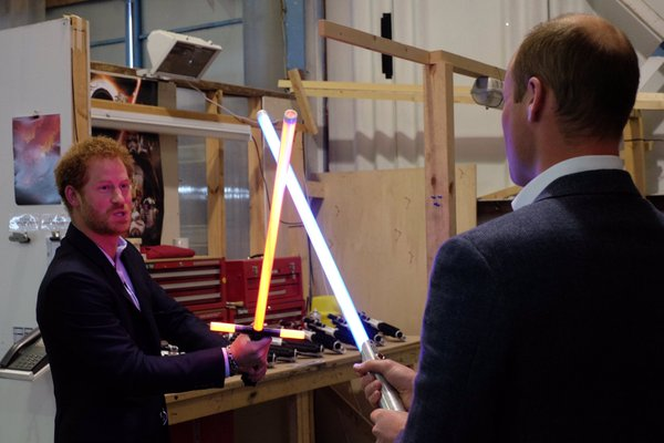 William and Harry play with lightsabers