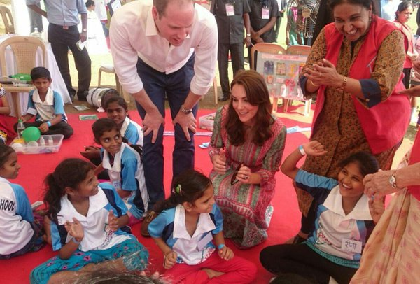William and Kate chat to local charity children during cricket