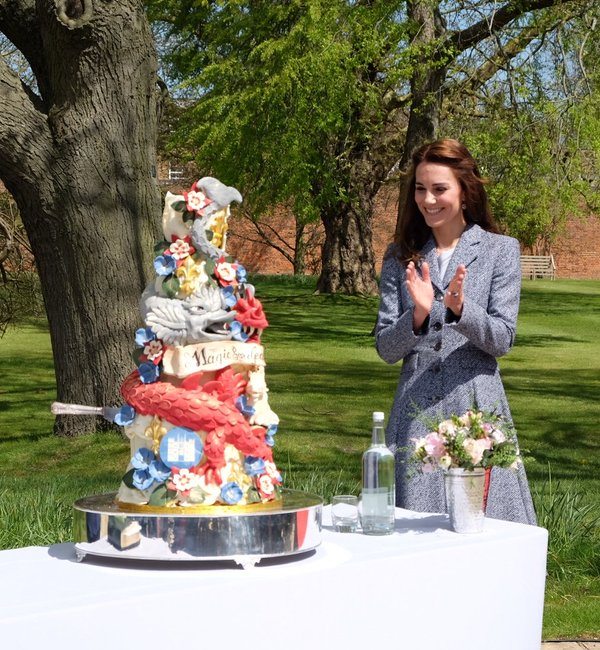 Kate with cake at Magic Garden