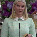 Mette-Marit speaks during Christening