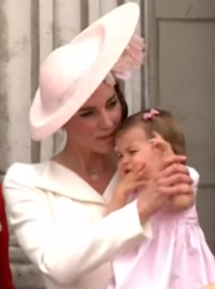 Kate pulling Charlotte's arm down Trooping the Color 2016